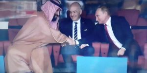 World Cup: two men smiling and shaking hands in the inaugural game