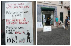 sign saying painting with coffee and red wine in front of a Lisbon atelier