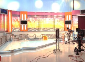 tv studio of an entertainment morning show with chairs and video equipment like cameras and strings
